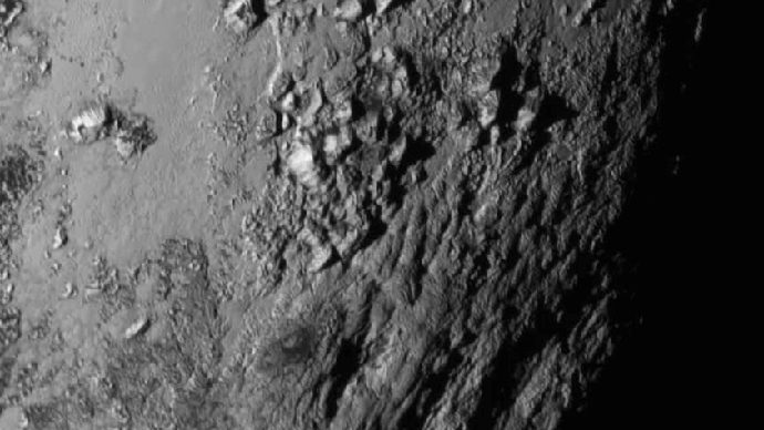 3,500m icy peaks of Pluto: NASA reveals striking images of dwarf planet (PHOTOS)