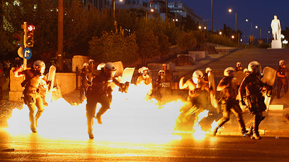 Tear gas v petrol bombs: Clashes mar massive Greek protest against bailout deal