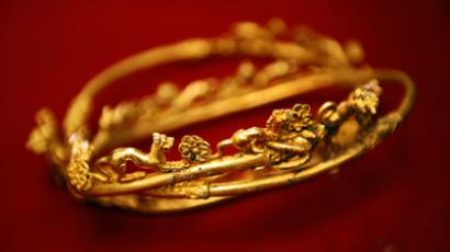 A golden tiara engraved with a lion's head and other animals is displayed, part of a Thracian treasure at the Archaeology Museum in Sofia on November 11, 2012 (AFP Photo / Dimitar Dilkoff)