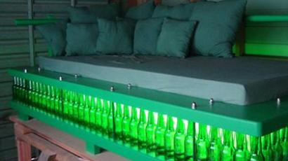 New Zealand-based carpenter sells his beer bottle bed for $3000 (image from http://www.stuff.co.nz)