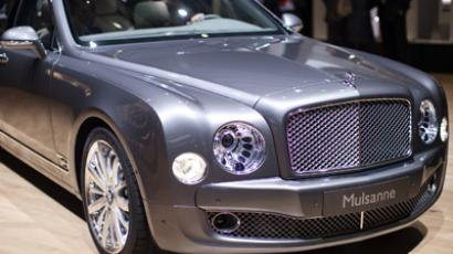The Bentley Mulsanne car is displayed on the car maker's booth during the first media day of the Geneva Auto Show at the Palexpo in Geneva, March 6, 2012. (Reuters/Valentin Flauraud)