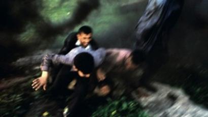 Explosion on the road to Kirkuk. Iraq, April, 2004 (Stanley Greene / NOOR)