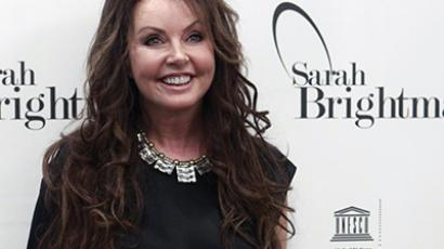 British singer Sarah Brightman smiles after a news conference in Moscow October 10, 2012. (Reuters / Sergei Karpukhin)