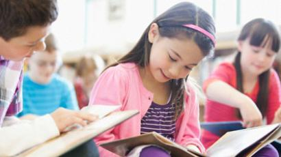 Kids who read books outside class achieve better results in school, according to research.
