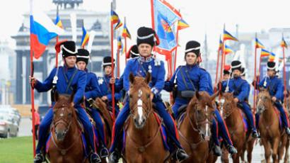 Russian Cossacks ride during the beginning of a march to Paris at the Poklonnaya Gora War Memorial Park in Moscow.(REUTERS / Sergei Karpukhin)