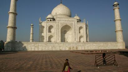 An Indian tourist walks past the UNESCO World Heritage site Taj Mahal.(AFP Photo / Andrew Caballero-Reynolds)