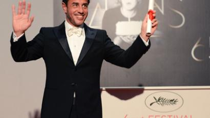 Italian director Matteo Garrone poses during a photocall after being awarded with the Jury Grand Prix for the film Reality during the 65th Cannes film festival on May 27, 2012 in Cannes (AFP Photo/Anne-Christine Poujoulat)