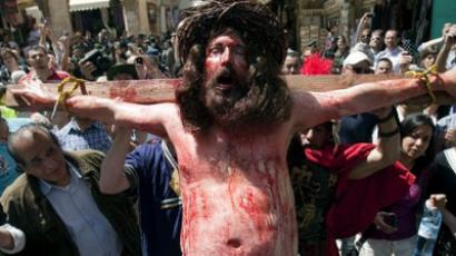 "Tony Khalil, a Christian pilgrim from Nazareth, reenacts the crucifixion of Jesus Christ along the path where Jesus walked, now known as the ""Via Dolorosa"", or the ""Way of Suffering"", on Good Friday in Jerusalem's Old City on April 6, 2012 (AFP Photo / Ahmad Gharabli)"
