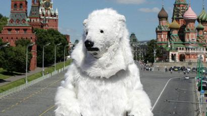 A man dressed like a polar bear roamed historical Red Square to the surprise of Muscovites and tourists (Greenpeace / Igor Podgorny)