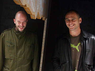 Artists Jake (2nd R) and Dinos Chapman (R). (AFP Photo / Adrian Dennis)