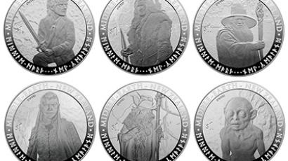A set of three NZ$1 (0.82USD) coins bearing images of characters from the upcoming new Hobbit film trilogy, in Wellington on October 10, 2012.  (AFP Photo)