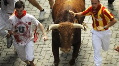 Participants run with El Pilar bulls during the fourth bull run of the San Fermin Festival, on July 10, 2012, in the Northern Spanish city of Pamplona. (AFP Photo/Rafa Rivas) Video uploaded to YouTube on 10.07.2012 by NebredaTV