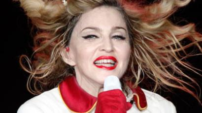 U.S. singer Madonna performs on stage during her MDNA tour at the Olympic Stadium in Moscow.(Reuters / Maxim Shemetov)