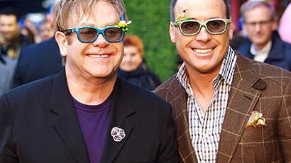 British pop superstar Elton John and his partner David Furnish. (AFP Photo / Max Nash)