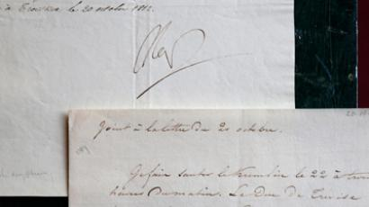 A rare letter written in code (Top) by French Emperor Napoleon Bonaparte during his Russian military campaign and its decoded version are displayed at a Paris auction house (Reuters / Charles Platiau)