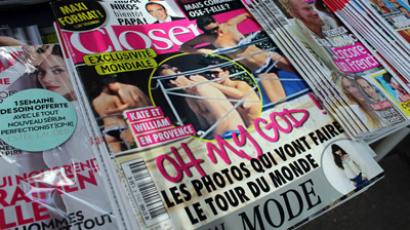 Copies of the celebrity magazine Closer, which published topless pictures of Prince William's wife Catherine, Duchess of Cambridge, taken while the pair were on holiday in France on September 5, are displayed at a newsstand in Paris on September 14, 2012 (AFP Photo / Thomas Samson)
