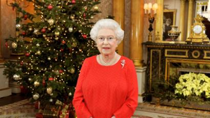 Queen Elizabeth II stands in the 1844 Room of Buckingham Palace in London after recording her Christmas Day television broadcast to the Commonwealth (AFP Photo / John StillwellS)