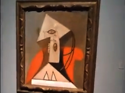 Woman in a red armchair by Pablo Picasso spray-painted  (Screenshot from youtube video user @fused00828)