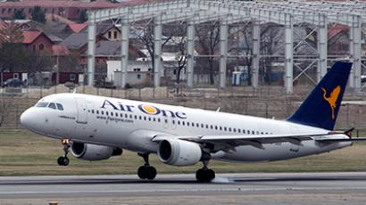 An Air One Airline Airbus A320 plane lands at Henri Coanda Airport in Otopeni, near Bucharest (Reuters/Bogdan Cristel)
