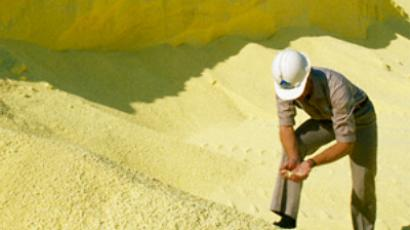 A worker checks fertilizer