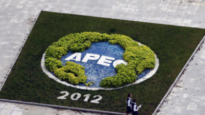 Two volunteers walk outside of the media center for the Asia-Pacific Economic Cooperation (APEC) summit in Vladivostok.(AFP Photo / Laurent Fievet)