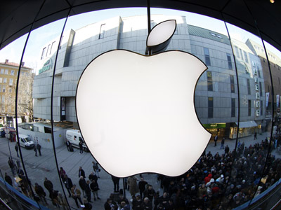 People wait on a street in front of an Apple store as they await sales of the new iPad in the Apple store in Munich March 16, 2012. (Reuters / Michaela Rehle)