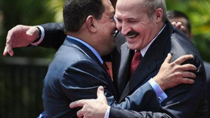 "Venezuela: Venezuelan Presidente Hugo Chavez (L) and Belarussian President Alexander Lukashenko hug each other at the ""Miraflores"" presidential palace in Caracas March 15, 2010. (AFP Photo / Juan Barreto)"