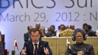 Dimitry Medvedev (L) and Manmohan Singh during the BRICS summit in New Delhi on March 29, 2012 (AFP Photo / Prakash Singh)