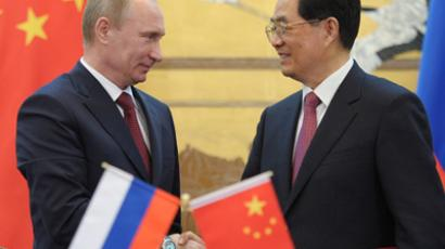 Chinese President Hu Jintao and his Russian counterpart Vladimir Putin shake hands during a signing ceremony at the Great Hall of the People in Beijing on June 5, 2012. (RIA-Novosti / Alexey Druzhinin)