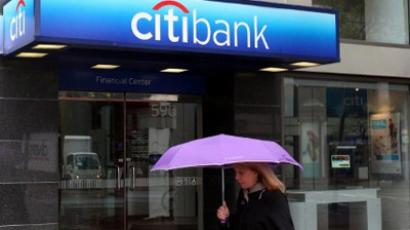 A pedestrian walks by a CitiBank branch office. (Justin Sullivan/Getty Images/AFP)