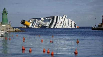 The cruise liner Costa Concordia lies aground in front of the Isola del Giglio (Giglio island) on January 23, 2012 after hitting underwater rocks (AFP Photo / FILIPPO MONTEFORTE)