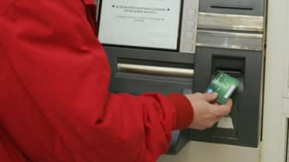 Drawing money from the ATM. RIA NOVOSTI / Maksim Bogodvid