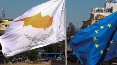 Cypriot flag fluttering next to the European Union flag at the Davila Moat in Nicosia, marking Cyprus' assumption of the EU presidency on July 1. (AFP Photo)