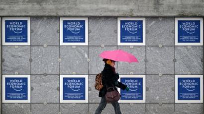 A woman passes the congress center on January 21, 2013 at the Swiss resort of Davos (AFP Photo / Johannes Eisele)