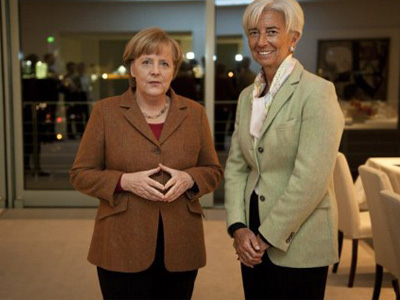 Berlin: Photo released by German government shows Chancellor Angela Merkel (L) posing with IMF chief Christine Lagarde. (AFP Photo / Bundesregierung)