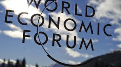 The mountains of Switzerland are reflected in a sign of the World Economic Forum (WEF) at the Swiss resort of Davos on January 26, 2012.  (AFP Photo / Fabrice Coffrini)