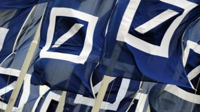 Flags with the logo of German bank Deutsche Bank (AFP Photo/Arne Dedert)