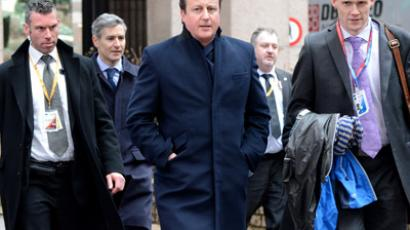 British Prime Minister David Cameron (C) arrives at the EU Headquarters on February 8, 2013 in Brussels, on the last day of a two-day European Union leaders summit. (AFP Photo/Thierry Charlier)