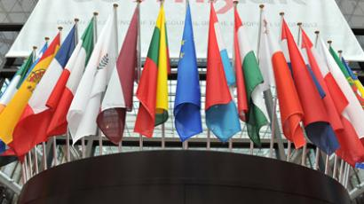 European flags a re displayed outsidethe great hall of the Brussels European Council on June 27, 2012 on the eve of the summit of European Heads of State scheduled to hold next two days (AFP Photo/Georges Gobet)