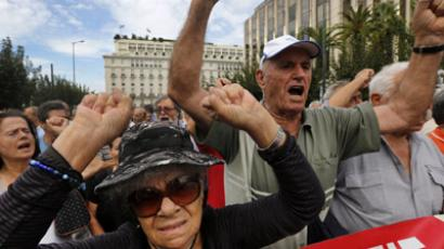 Pensioners shout slogans against the EU and the government during a march towards the EU offices in central Athens October 8, 2012. (Reuters/Yannis Behrakis)