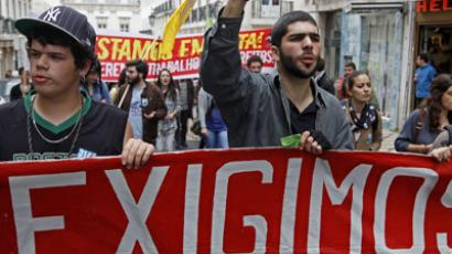 "Youth march with a banner saying ""We demand"" during a protest against unemployment and government austerity measures in Lisbon March 31, 2012. (Reuters/Jose Manuel Ribeiro)"