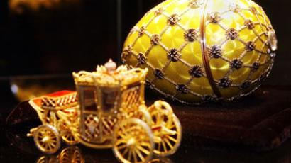 "The Faberge Coronation Egg with carriage, part of ""Imperial Treasures: Faberge from the Forbes Collection"".(AFP Photo / Stan Honda)"
