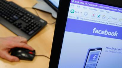 A Facebook page is displayed on a computer screen (Reuters/Thierry Roge)