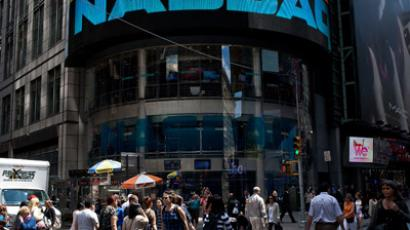 People walk past the Nasdaq exchange in Time Square on June 7, 2012 in New York City. The Nasdaq announced that they plan to set aside $40 million to handle legal proceedings surrounding the recent Facebook IPO. (Andrew Burton/Getty Images/AFP)