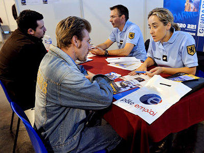 People ask for information at the stand of the French Gendarmerie during a job fair in Arras, northern France. (AFP Photo / Philippe Huguen)