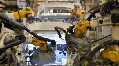 The Volkswagen Tiguan and Touran models are being welded by robots at the assembly line on March 7, 2012 in Wolfsburg, central Germany.  (AFP Photo / Odd Andersen)