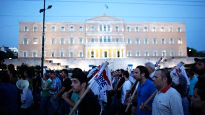 Steelworkers walk in front of the Labour Ministry building during a demonstration in Athens.(AFP Photo / Angelos Tzortzinis)
