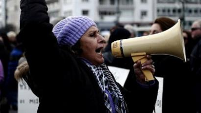 A health worker shouts slogans in a megaphone during a demonstration against the government's austerity measures in central Athens. (AFP Photo / Aris Messinis)