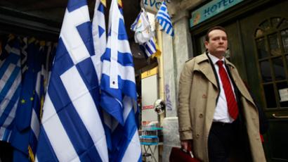 Fitch gives Greece benefit of the doubt