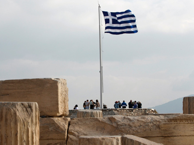 Greek national flag flies at the archaeological site of the Acropolis Hill in Athens (Reuters/John Kolesidis)